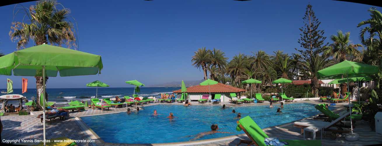 Panoramic View Of A Swimming Pool With Beach Bar In Stalis